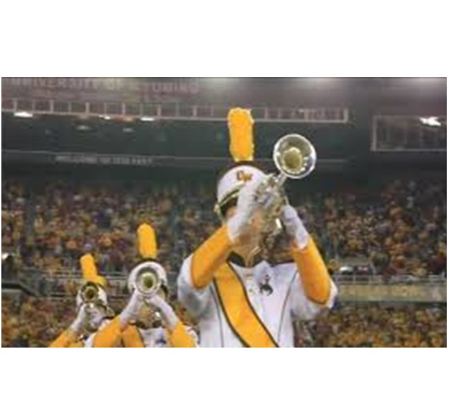 Wyoming Marching Bandthree players on field