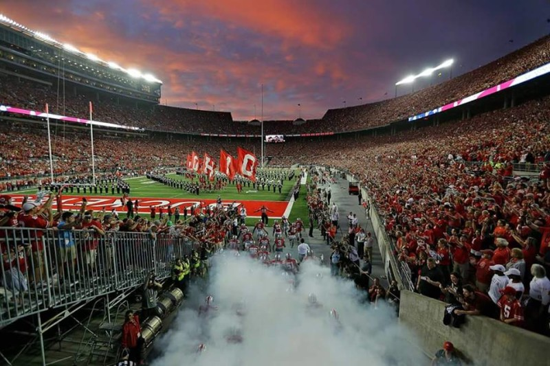 Ohio Stadium night game smoke as team enters